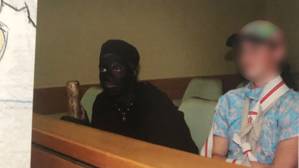 A 2017 yearbook photo from G.W. Graham Secondary School shows a student is wearing blackface in class for a mock trial. (Twitter/mykgayla)