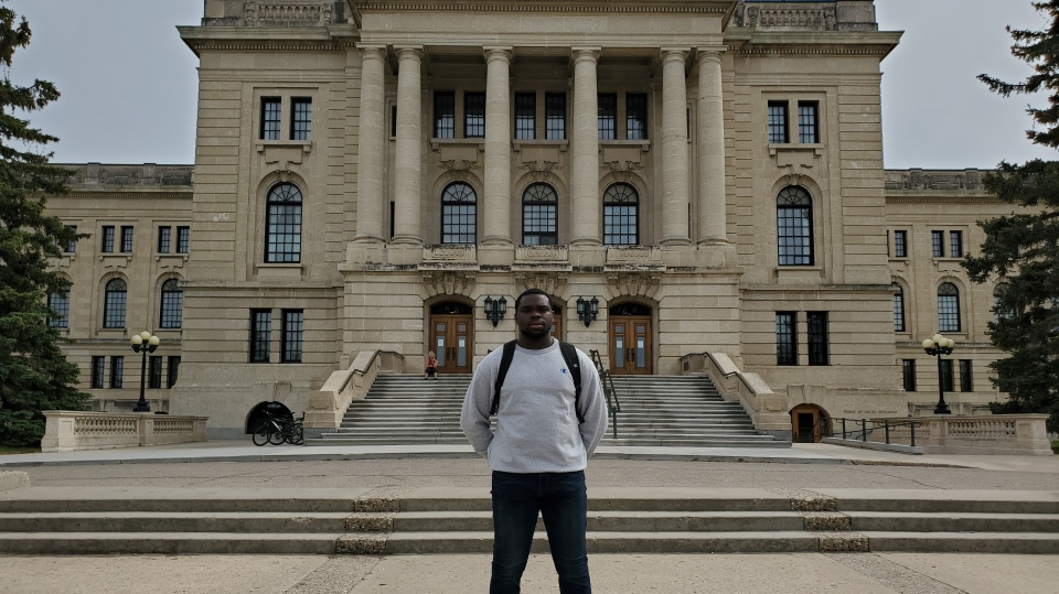 Tobi Omeyefa stands on the steps of the Saskatchewan Legislative Building. Omeyefa is using a petition to call on the Saskatchewan Government to include more black history in the curriculum. (Donovan Maess/CTV News)