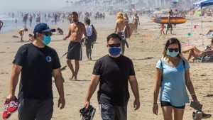 If you need to take off your mask at the beach, only do so when you're at least six feet away from others. (APU GOMES/AFP via Getty Images)
