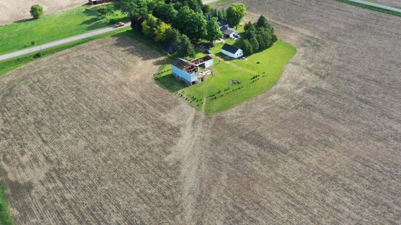Scour marks in a field lead right to a barn with its roof torn off in Belmont, Ont. following a tornado on Wednesday, June 10, 2020. (Source: Northern Tornadoes Project / Twitter)