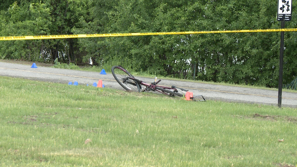 A damaged bicycle could be seen by the roadway a fatal crash involving a vehicle in the area of Island Park Drive and the Sir John A. Macdonald Parkway on June 10, 2020. (CTV News Ottawa)