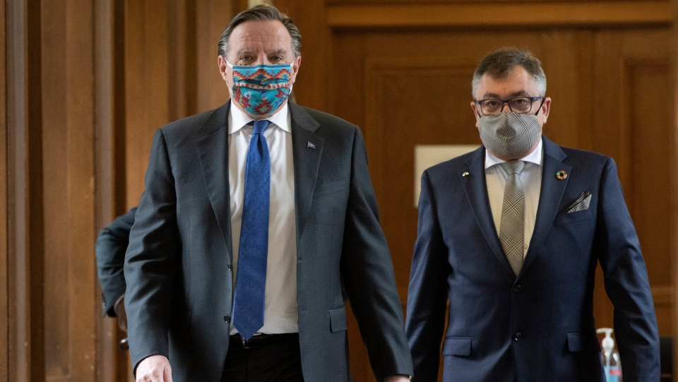 Quebec Premier Francois Legault, left, and Horacio Arruda, Quebec director of National Public Health walk to a news conference on the COVID-19 pandemic, Thursday, June 11, 2020 at the legislature in Quebec City. THE CANADIAN PRESS/Jacques Boissinot