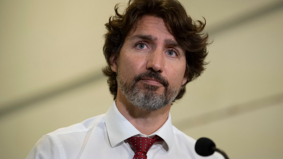 Prime Minister Justin Trudeau listens to a question during a news conference following a visit to a business in Ottawa, Thursday June 11, 2020. THE CANADIAN PRESS/Adrian Wyld