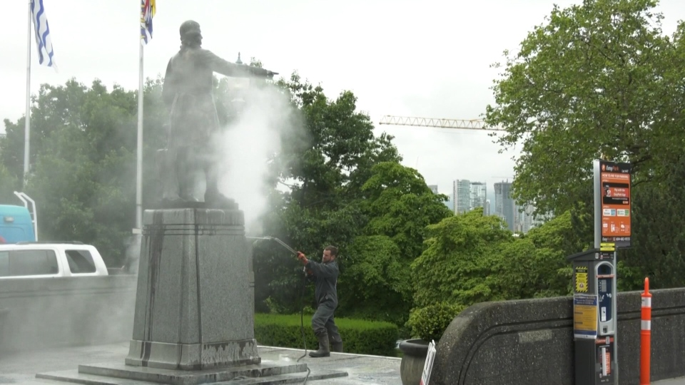 The statue of Capt. George Vancouver that stands outside the front steps to Vancouver City Hall had to be pressure-washed after it was defaced by paint Thursday.