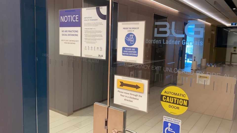 Signs on the door of Borden Ladner Gervais in Toronto remind employees about physical distancing and hygiene. (Courtesy Borden Ladner Gervais)