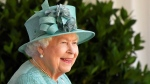 Queen Elizabeth II reacts as she looks out during a ceremony to mark her official birthday at Windsor Castle in Windsor, England, Saturday June 13, 2020. (Toby Melville/Pool via AP)