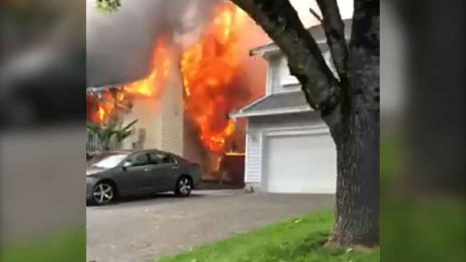 Fire crews were called to a massive house fire in Langley Saturday evening. (CTV)