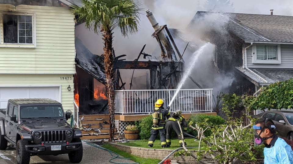 A massive house fire destroyed most of one home and significantly damaged another in Langley Saturday evening. (CTV)