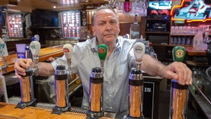 Ziggy Eichenbaum, owner of Ziggy's Pub, is seen in his bar Friday, June 12, 2020 in Montreal. As Quebec allows the reopening of restaurants that serve alcohol in the next two weeks bars without food are to remain closed. THE CANADIAN PRESS/Ryan Remiorz
