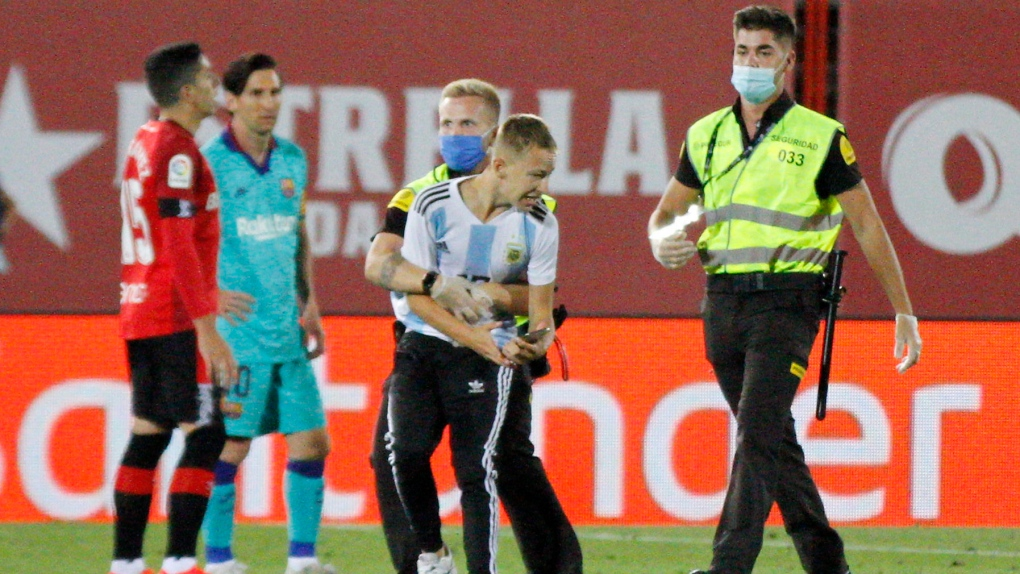 spanish soccer league to file charges against fan who invaded field ctv news spanish soccer league to file charges