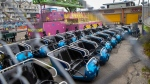 Cars detached from an amusement ride sit parked at Palace Playland, Wednesday, June 3, 2020, in Old Orchard Beach, Maine. (AP Photo/Robert F. Bukaty)
