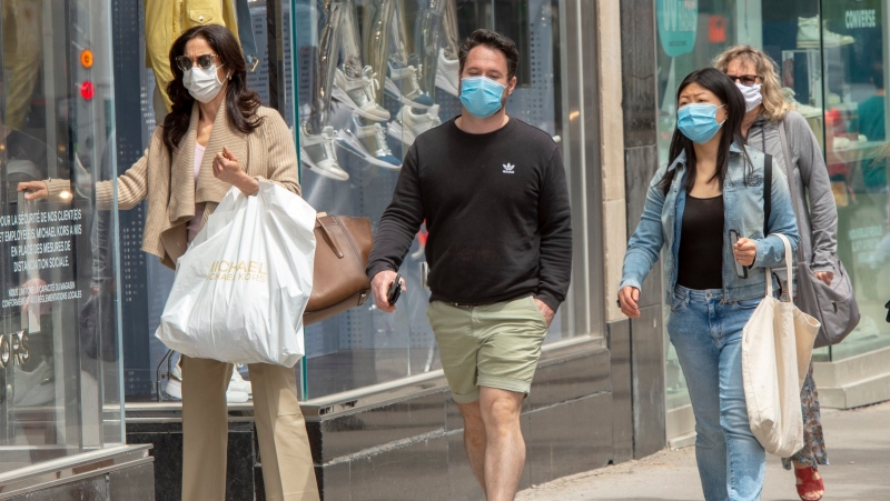 Shoppers walk along Ste. Catherine Street Tuesday, June 9, 2020 in Montreal. THE CANADIAN PRESS/Ryan Remiorz