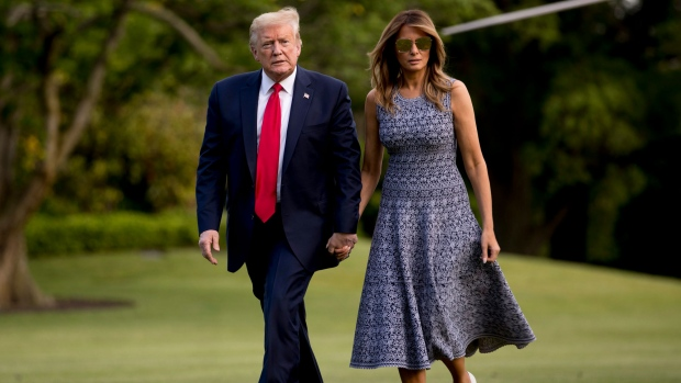President Donald Trump and first lady Melania Trump return to the White House in Washington, Wednesday, May 27, 2020. Trump returns from Florida after the launch of a rocket ship built by the SpaceX company was postponed due to bad weather. (AP Photo/Andrew Harnik)