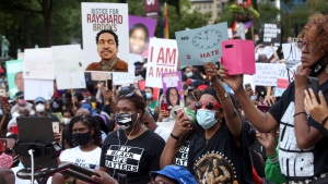 A crowd of demonstrators march to the Capitol. The NAACP March to the Capitol coincided with the restart of the Georgia 2020 General Assembly Monday, June 15, 2020 in Atlanta. The NAACP March to the Capitol coincided with the restart of the Georgia 2020 General Assembly. Lawmakers returned wearing masks and followed new rules to restart the session during the pandemic. (Steve Schaefer/Atlanta Journal-Constitution via AP)