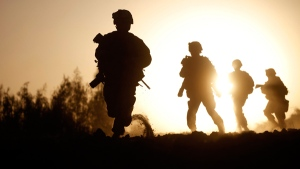 U.S. Marines run for new cover in Nawa district, Helmand province, southern Afghanistan, Friday, Oct. 2, 2009. (AP / Brennan Linsley)