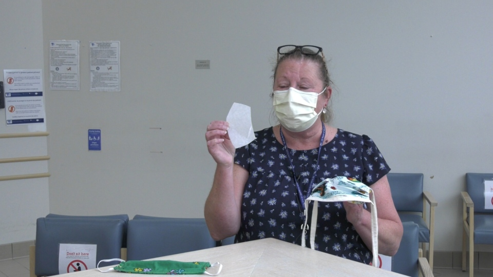Lorna Green, manager of oncology, nephrology and pharmacy at Timmins and District Hospital shows how one of the donors created a mask that allows for the added layer of filtration from a coffee filter. Jun 16/20 (Lydia Chubak/CTV Northern Ontario)