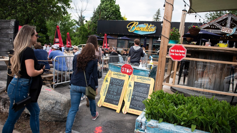 Patrons led to their seats on patio at Banditos