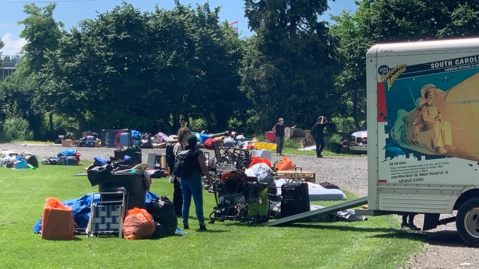 Homeless campers move into Strathcona Park with help from volunteers who rented a moving van for them on Tuesday, June 16, 2020.