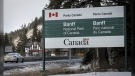 The Banff National Park entrance is shown as Parks Canada is restricting vehicles in the national parks and national historic sites in Banff, Alta. The federal environment minister says Canadians who have campground reservations in some national parks will be allowed to pitch their tents and pull in their trailers starting next week. (Jeff McIntosh/The Canadian Press)