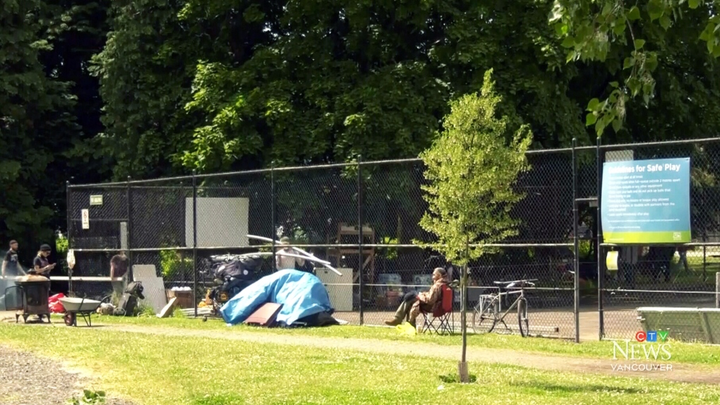Tent city moves from parking lot to soccer pitch