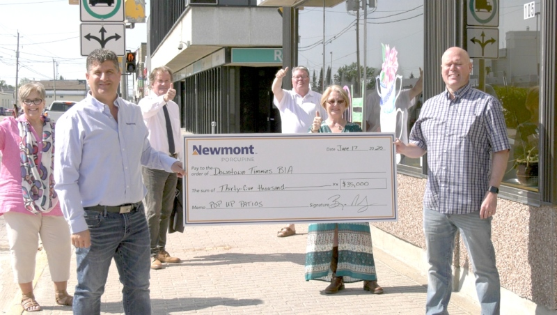 Newmont Porcupine hands over a $35,000 cheque to Jamie Roach, Downtown Timmins BIA board president.  It will allow for 10 restaurants that operate downtown to have pop-up patios in front of their eateries in hopes of generating business during the COVID-19 pandemic. (Lydia Chubak/CTV News)