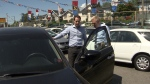Ross McLaughlin checks out used cars on a Vancouver lot.