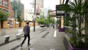 A man walks down Granville Street during the 2020 pandemic.