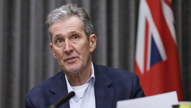Manitoba Premier Brian Pallister speaks at the Manitoba legislature in Winnipeg Monday, March 30, 2020. THE CANADIAN PRESS/John Woods