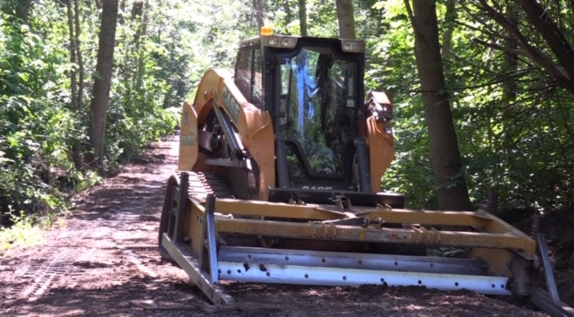 Farmer's grading machine used to redevelop path