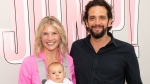Amanda Kloots, left, poses with her husband, actor Nick Cordero, and their son Elvis. (Noam Galai/Getty Images)