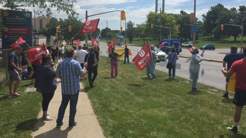 Health-care workers rally over pandemic pay outside the London Health Sciences Centre in London, Ont. on Friday, June 19, 2020. (Bryan Bicknell / CTV News)