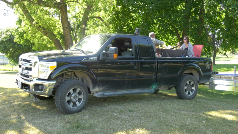 Billy Onion and Vicki-Lynn Cassidy enjoy dinner in the back of their truck at Victoria Park in Smiths Falls. (Nate Vandermeer/CTV News Ottawa)