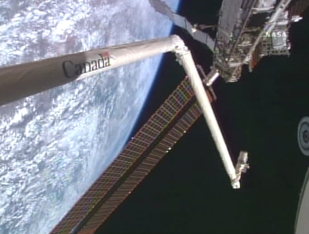 Canadarm is extended from the space shuttle Endeavour during operations with the International Space Station on Wednesday, Aug. 15, 2007.