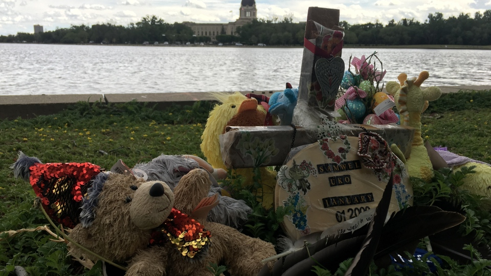 A memorial for Samwel Uko at Wascana Lake is pictured. (Cole Davenport / CTV News Regina)