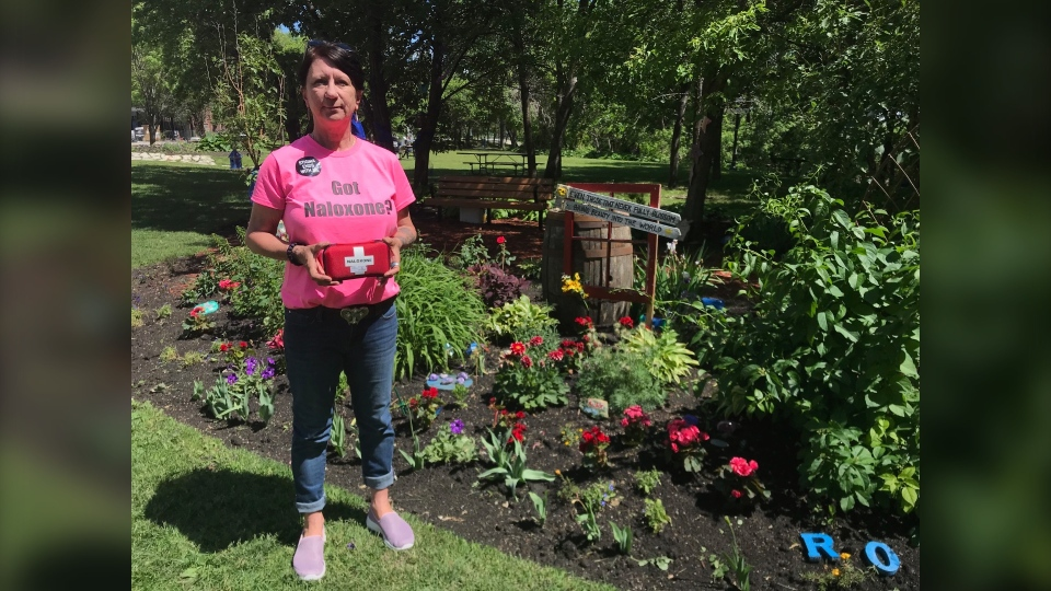 Arlene Last-Kolb stands with a Naloxone kit at a memorial garden in Stephen Juba Park in memory of people who've died of overdoses. (CTV News Photo Josh Crabb)