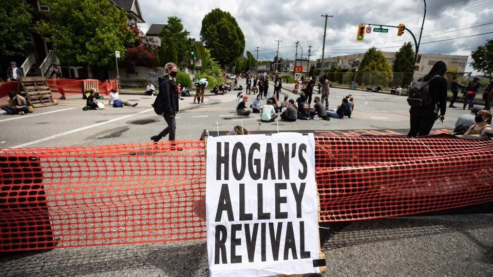 Demonstrators block access to the Dunsmuir and Georgia viaducts during an anti-racism protest held in support of Black Lives Matter, in Vancouver, B.C., Saturday, June 13, 2020. The eastern end of the viaducts sit on what was known as Hogan's Alley, home to Black residents and businesses, before they were displaced when the city attempted to revitalize the area from the 1930s onwards. THE CANADIAN PRESS/Darryl Dyck