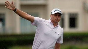 In this photo taken Thursday, June 18, 2020 Nick Watney signals after a tee shot during the first round of the RBC Heritage Golf tournament at Harbour Town Golf Links in Hilton Head, S.C. (AP Photo/Gerry Broome)