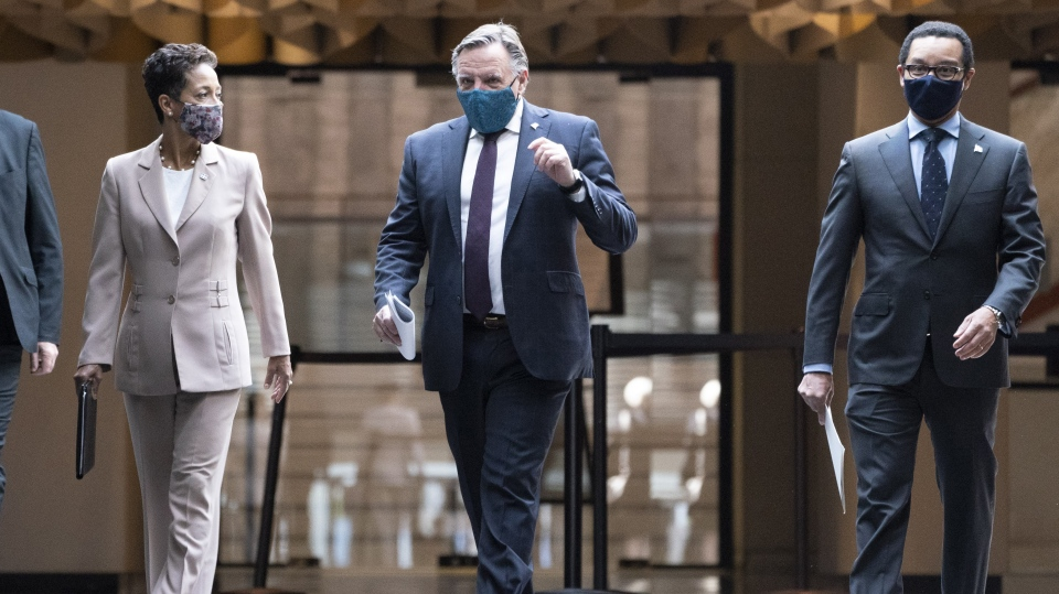 Quebec Premier Francois Legault arrives at a new conference with Nadine Girault, Minister of International Relations and La Francophonie, and Lionel Carmant, Minister for Health and Social Services, in Montreal, on Monday, June 15, 2020. THE CANADIAN PRESS/Paul Chiasson