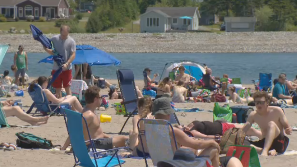 Beaches, such as Rainbow Haven in Cow Bay, N.S., were busy spots for those seeking a way to cool off on the unusually hot day.