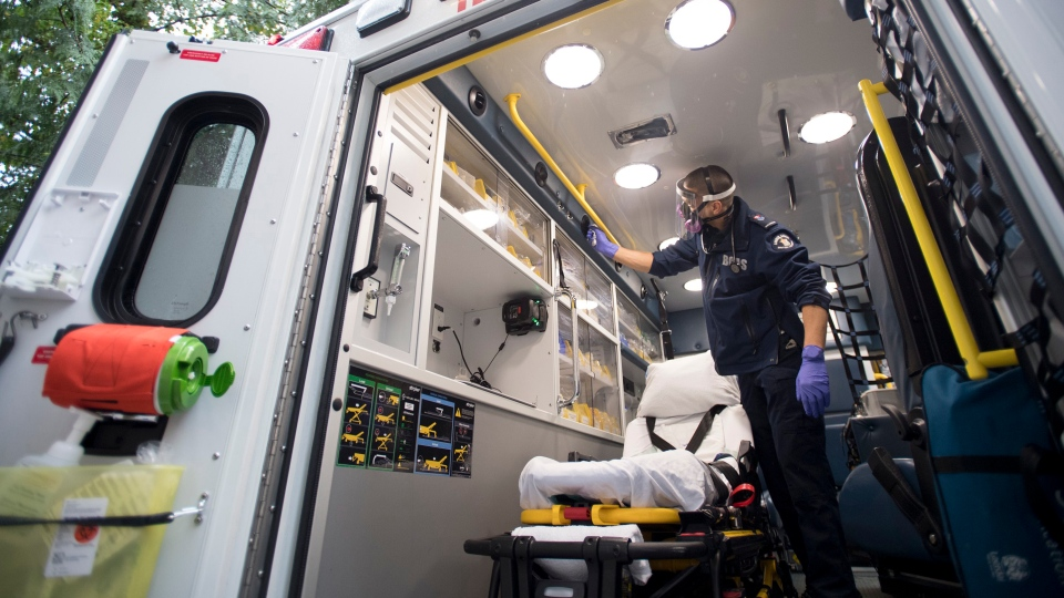 B.C. Ambulance paramedic Jeff Booton cleans his ambulance at station 233 in Lions Bay, B.C. Wednesday, April 22, 2020. (THE CANADIAN PRESS / Jonathan Hayward)