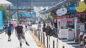 A man roller blades in the Old Port of Montreal, Saturday, June 20, 2020, as the port launches its 2020 summer season. The COVID-19 pandemic continues in Canada and around the world. (THE CANADIAN PRESS/Graham Hughes)
