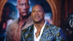 "Actor Dwayne Johnson arrives at the Los Angeles premiere of ""Jumanji: The Next Level,"" at the TCL Chinese Theatre, Monday, Dec. 9, 2019. The actor is set to host a globally broadcast concert calling on world leaders to make coronavirus tests and treatment available and equitable for all. (Photo by Jordan Strauss/Invision/AP)"