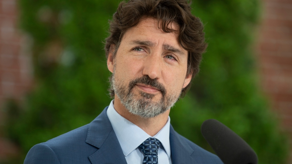 Prime Minister Justin Trudeau listens to a question during a news conference outside Rideau Cottage in Ottawa, Monday June 22, 2020. THE CANADIAN PRESS/Adrian Wyld