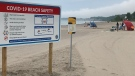 A new sign outlines pandemic beach safety at a Port Stanley, Ont. beach on Monday, June 22, 2020. (Sean Irvine / CTV News)