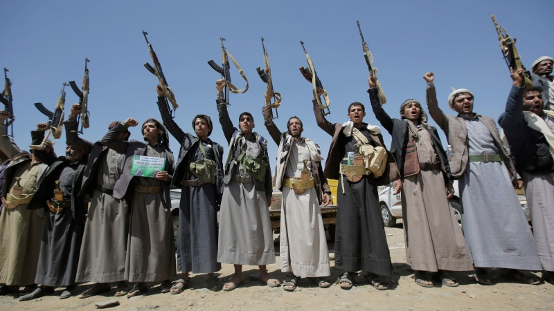 In this Sept. 21, 2019, file photo, Shiite Houthi tribesmen hold their weapons as they chant slogans during a tribal gathering showing support for the Houthi movement, in Sanaa, Yemen. (AP Photo/Hani Mohammed, File)