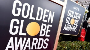 In this Jan. 6, 2019 file photo, Golden Globes signage appears on the red carpet at the 76th annual Golden Globe Awards in Beverly Hills, Calif. The Hollywood Foreign Press Association says the ceremony will be held Feb. 28. (Photo by Jordan Strauss/Invision/AP, File)