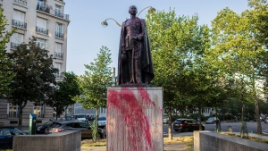 The statue of Hubert Lyautey, who served in Morocco, Algeria, Madagascar and Indochina when they were under French control, is offered with red painting Monday, June 22, 2020. (AP Photo/Rafael Yaghobzadeh)