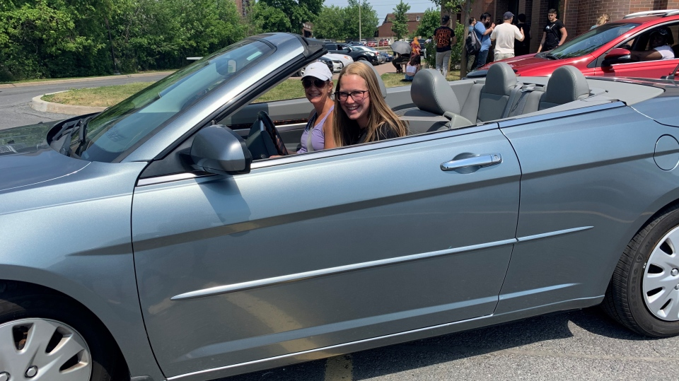 After waiting in line Monday to take her G1 driver's license test, 16-year-old Victoria Pears drives off with her mom in the passenger seat. (Saron Fanel / CTV News Ottawa)