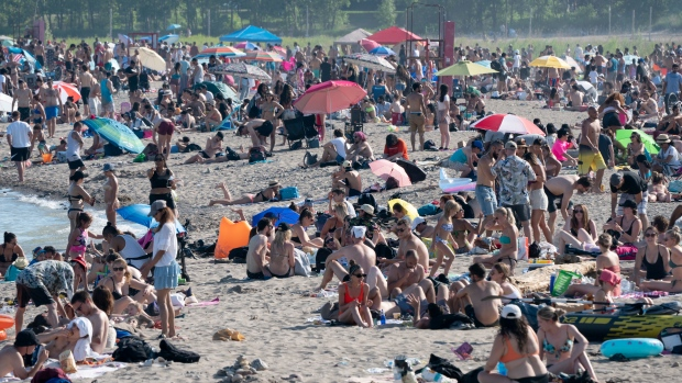 Thousands of people spend time on Woodbine Beach in Toronto on Saturday June 20, 2020. THE CANADIAN PRESS/Frank Gunn