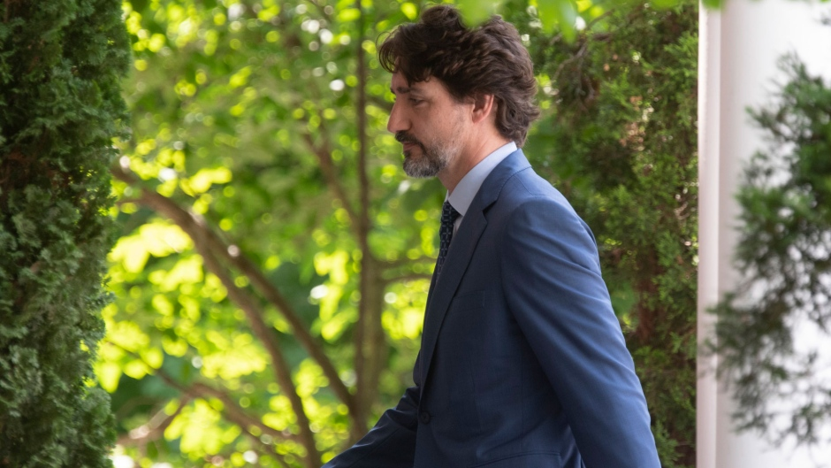 Prime Minister Justin Trudeau returns to Rideau Cottage following a news conference in Ottawa, Monday June 22, 2020. THE CANADIAN PRESS/Adrian Wyld
